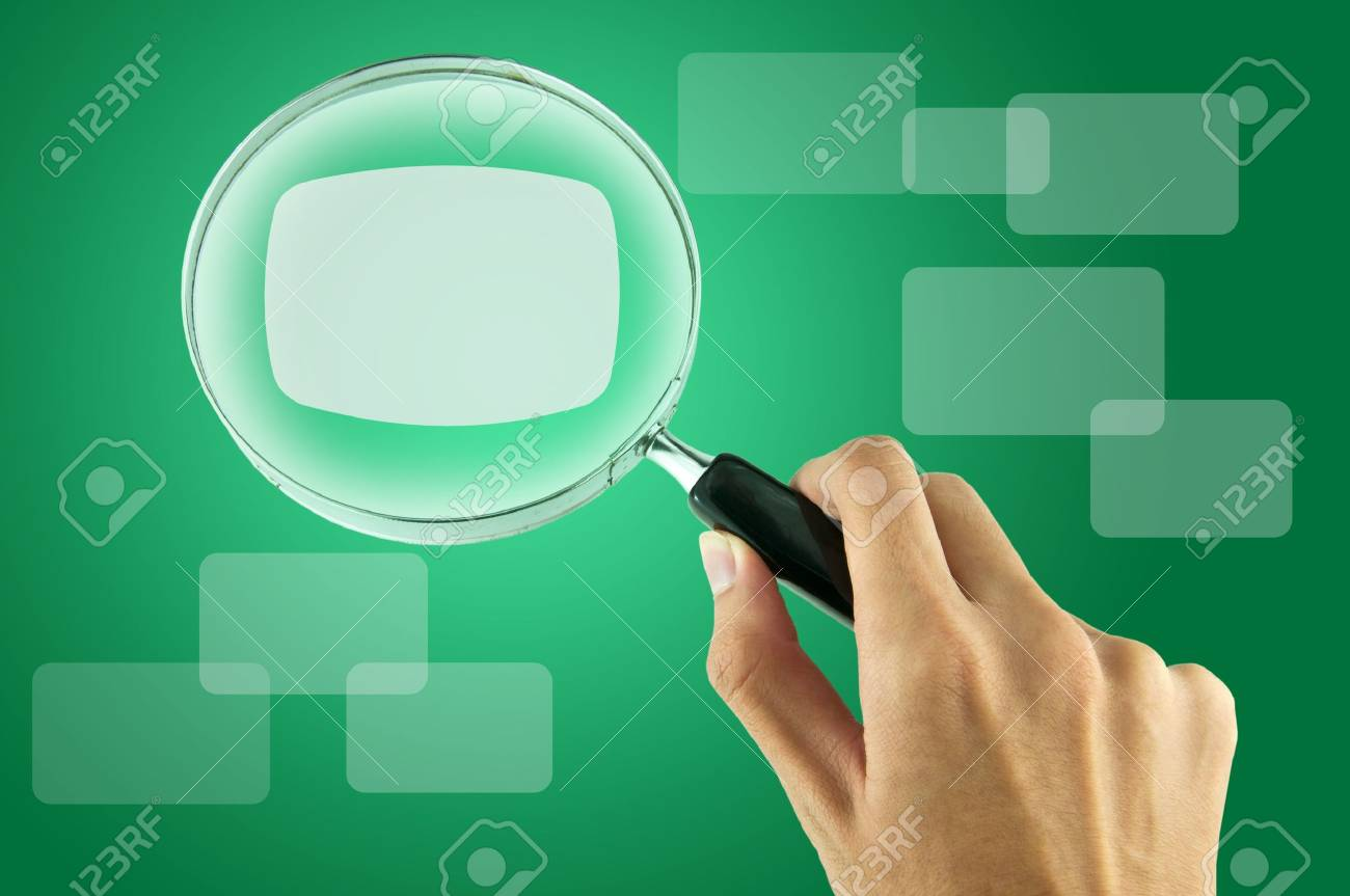 Magnifying glass and the working paper with a diagram. (Business concept) Stock Photo - 9308175