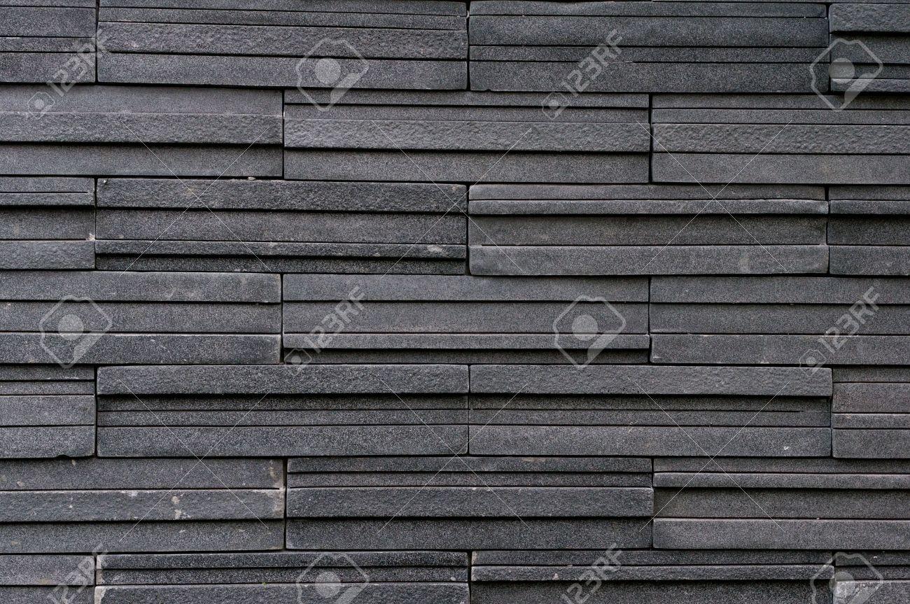 azulejo de piedra oscura textura de la pared de ladrillo superficie foto de archivo