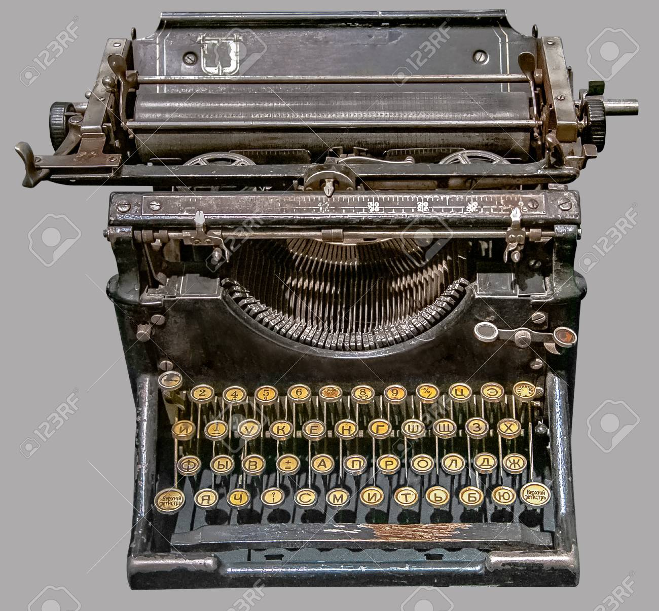 d34d97aa555 ANTIQUE RUSSIAN TYPEWRITER. Old vintage Russian typewriter on isolated gray  background with clipping path.