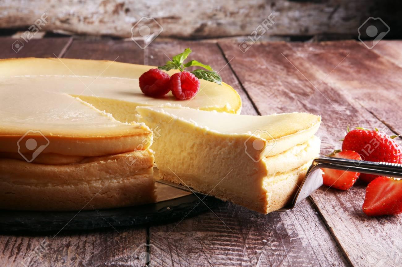 Homemade cheesecake with fresh strawberries and mint for dessert - healthy organic summer dessert pie cheesecake. Vanilla Cheese Cake. - 86214075