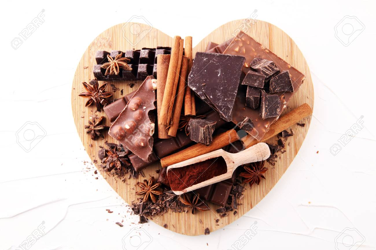 Chocolate concept with assorted chocolate, powder and spice. - 89842150