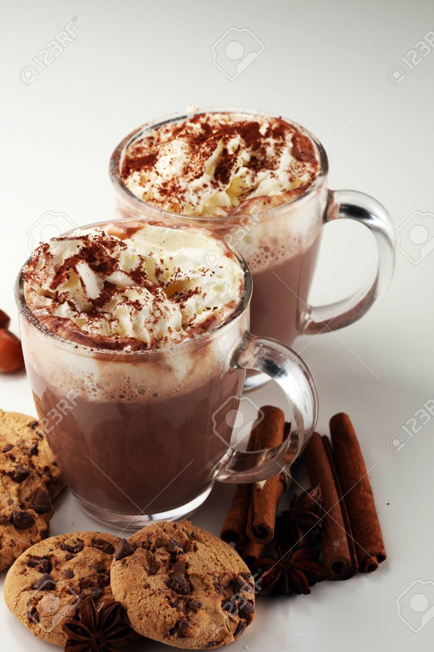 Hot chocolate cocoa with whipped cream on table - 111135640
