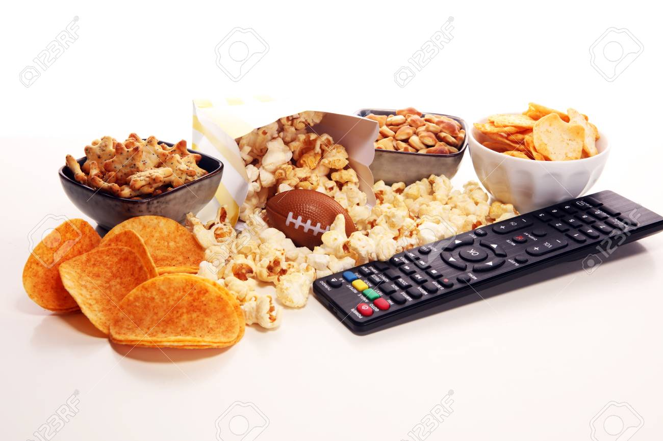 Chips, salty snacks, football on a table. Great for Bowl Game. - 115768077