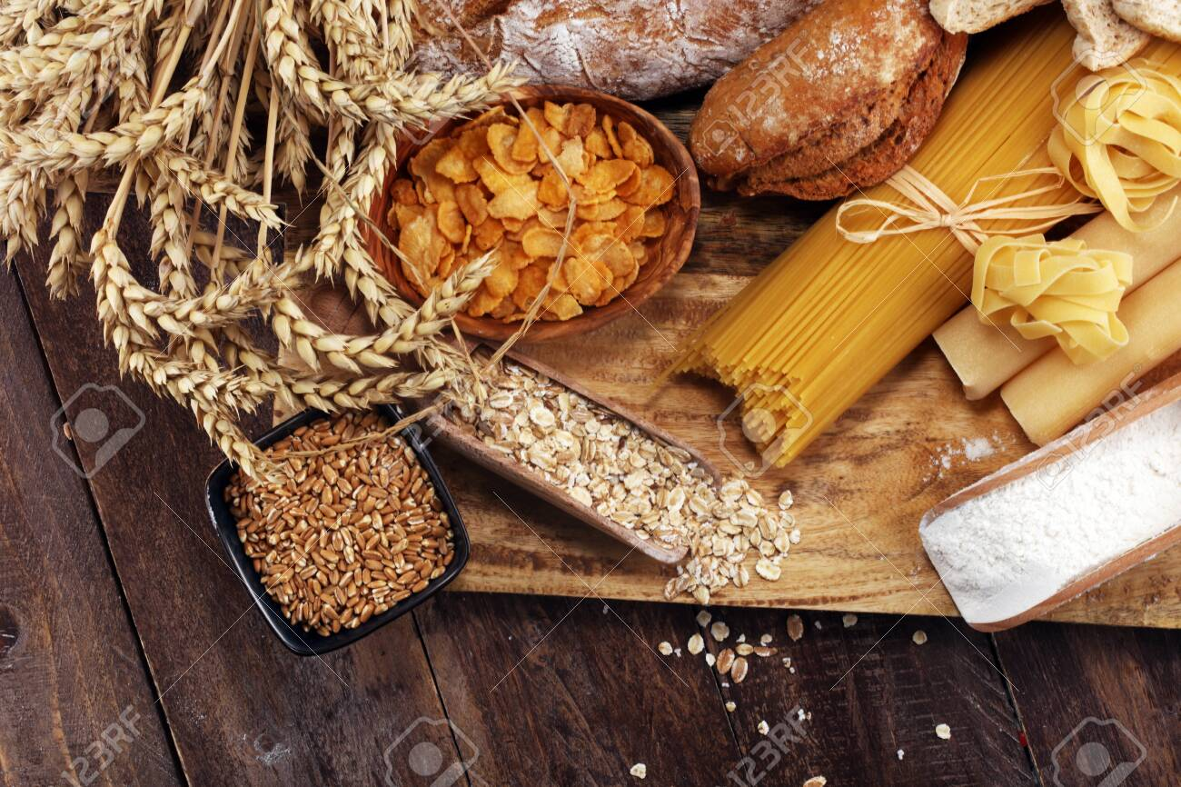 whole grain products with complex carbohydrates on rustic table - 121465691