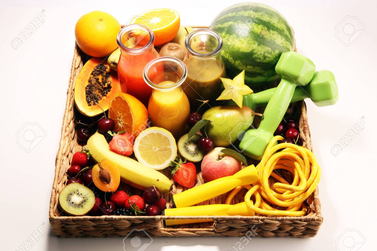Healthy fruits lifestyle concept. healthy smoothies and sport fitness equipment, dumbbells and jumping rope. - 123590715