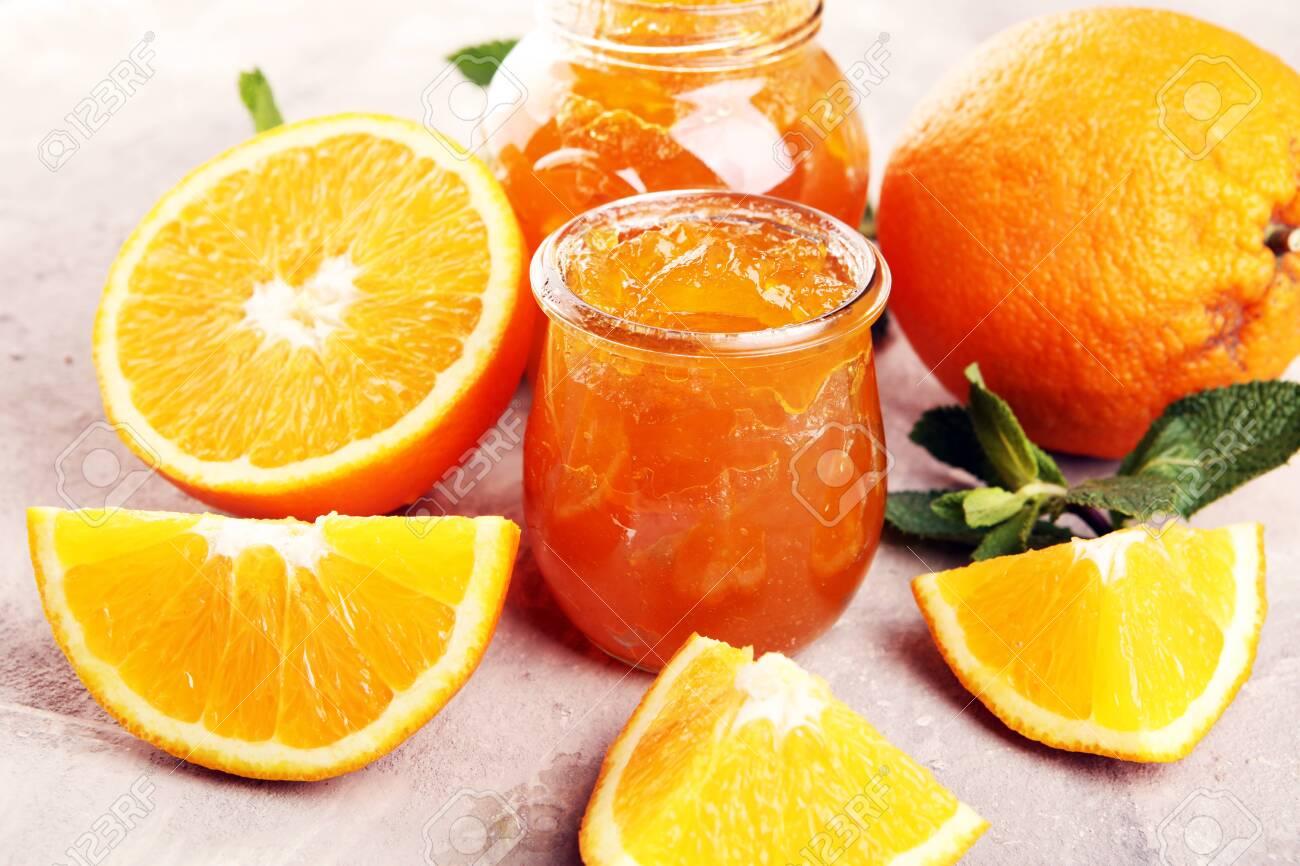 orange homemade jam marmelade in a glass jar. fresh juicy jelly - 137212842