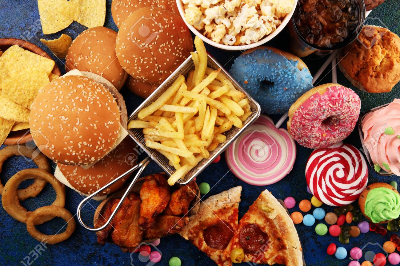 Unhealthy products. food bad for figure, skin, heart and teeth. Assortment of fast carbohydrates food with fries and cola - 137487276