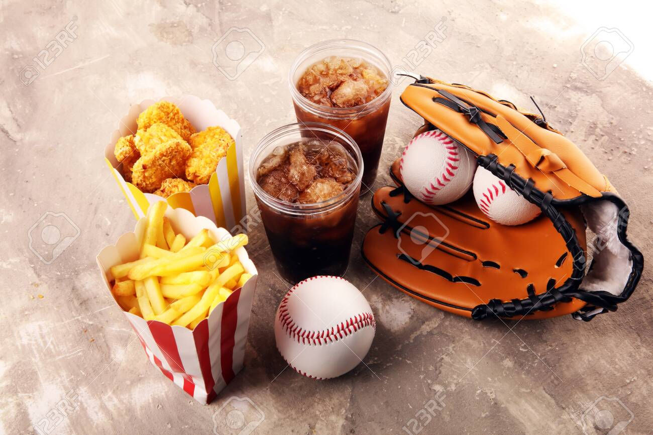 Chicken nuggets and french fries on the table with cola softdrink. Baseball party food - 141763689