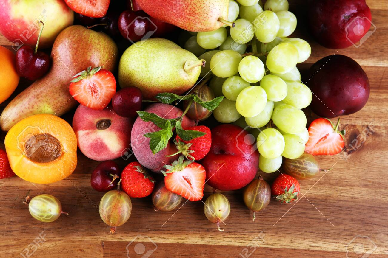 Fresh summer fruits with apple, grapes, berries, plums and organic apricot. - 151121798