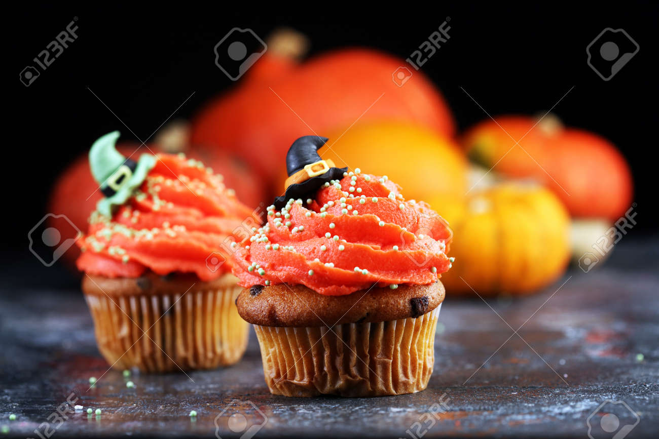 halloween cupcake and pumpkin on a dark background. sweets with cupcakes for the celebration - 159164946