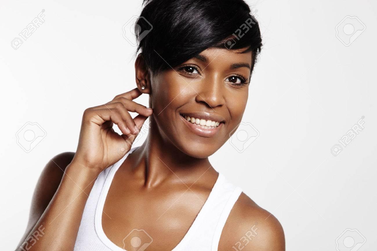 black woman smiling and looking at camera - 34674511