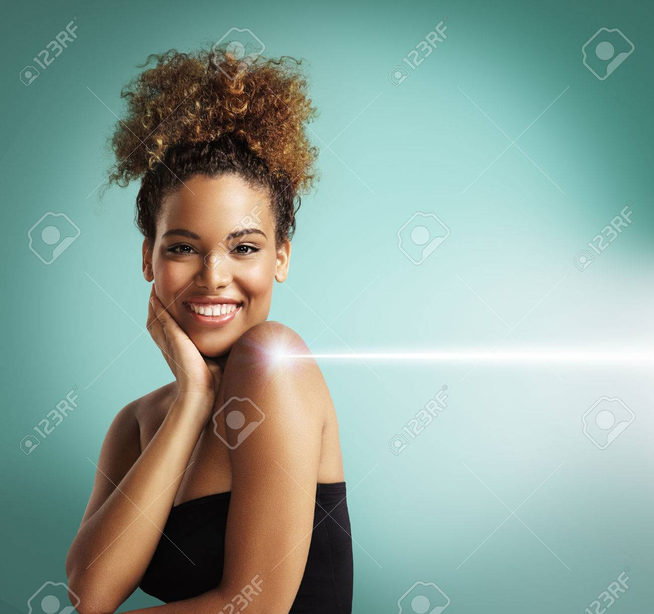 happy woman making a laser cosmetology procedure - 34674935