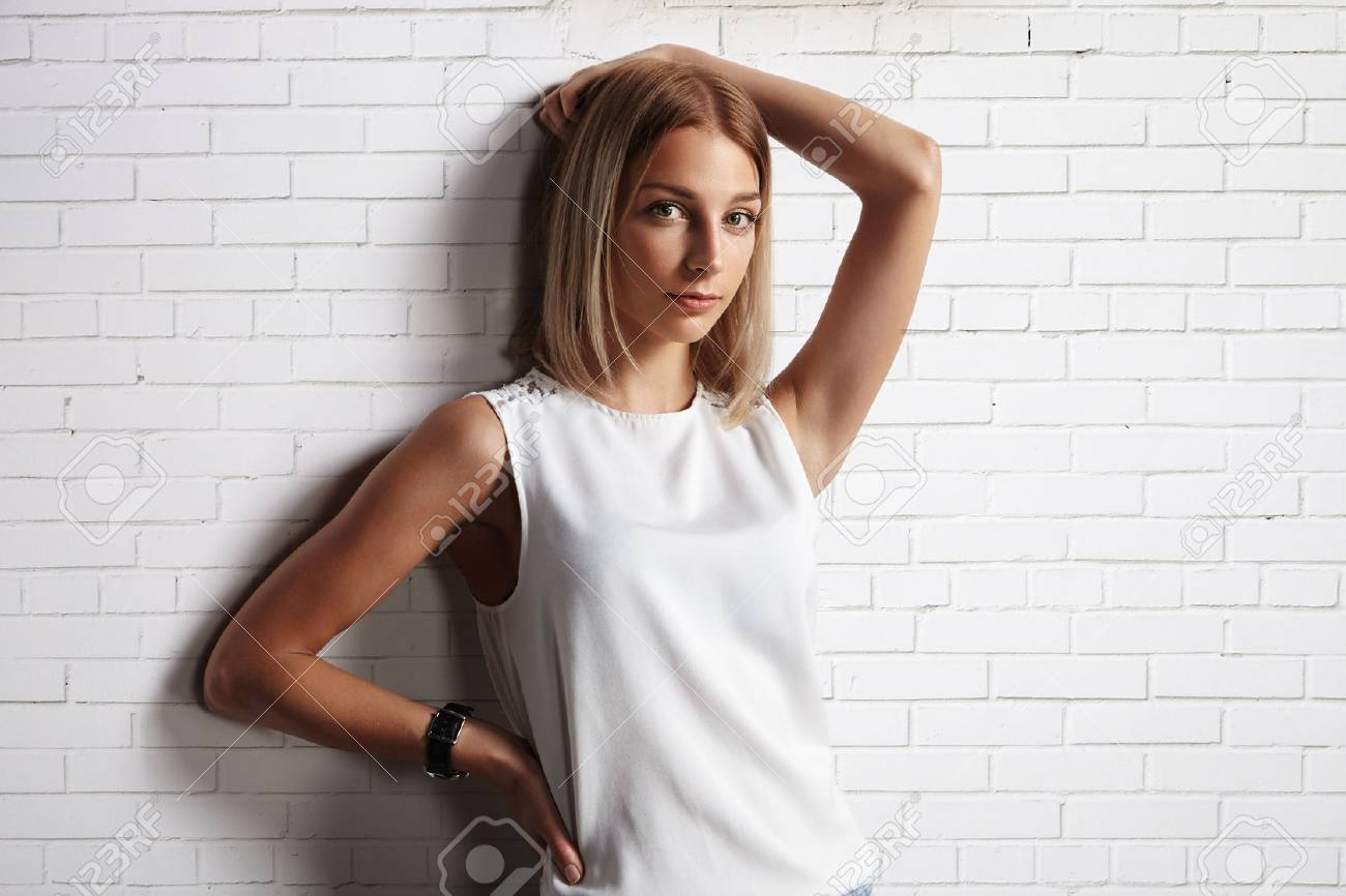 woman in a blank t-shirt. brick wall background - 34676673