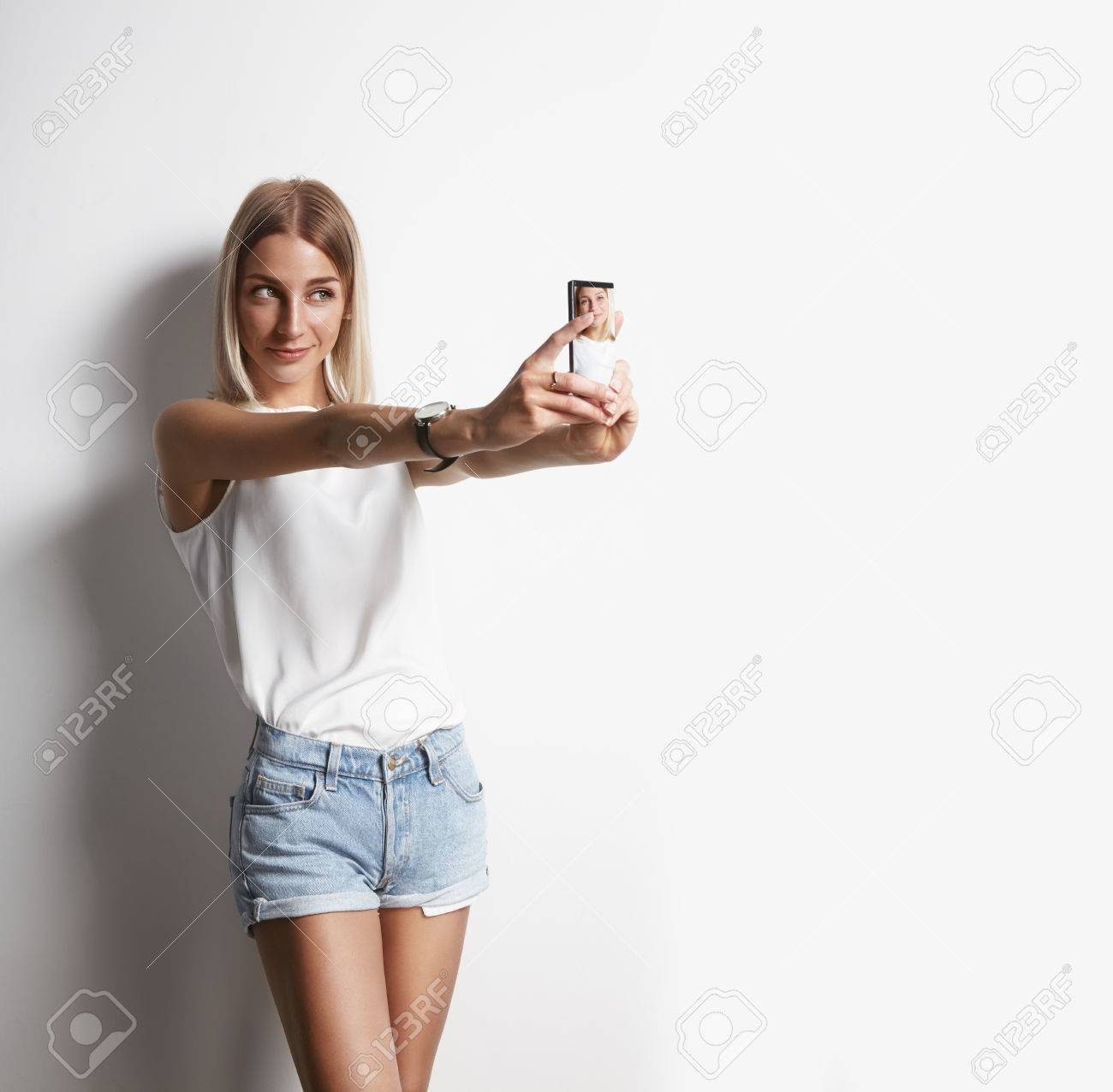 girl making selfie with a mobile phone - 34676855