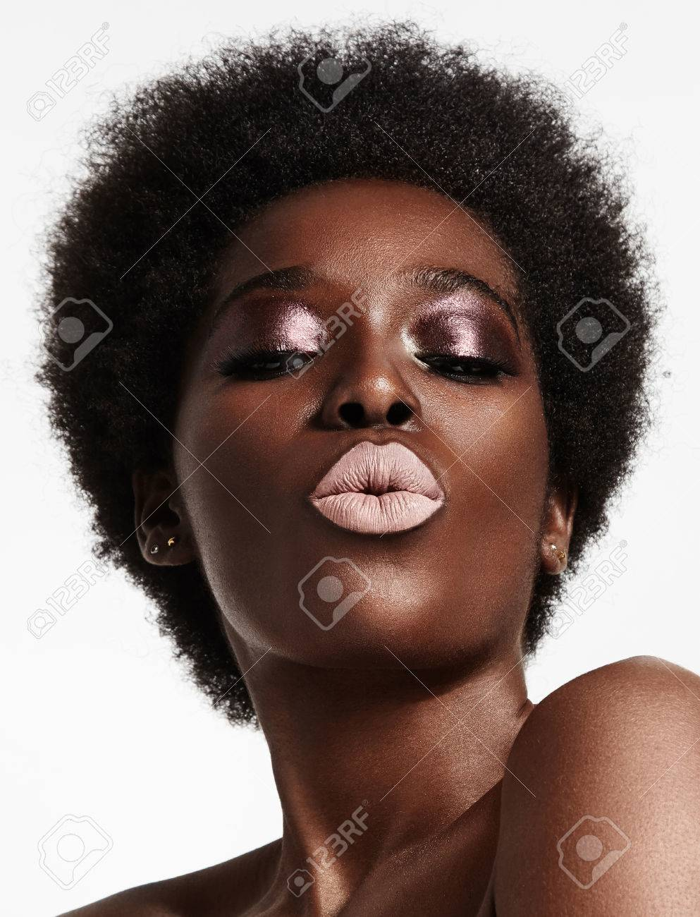 black woman with a short afra and bright lips - 45147414