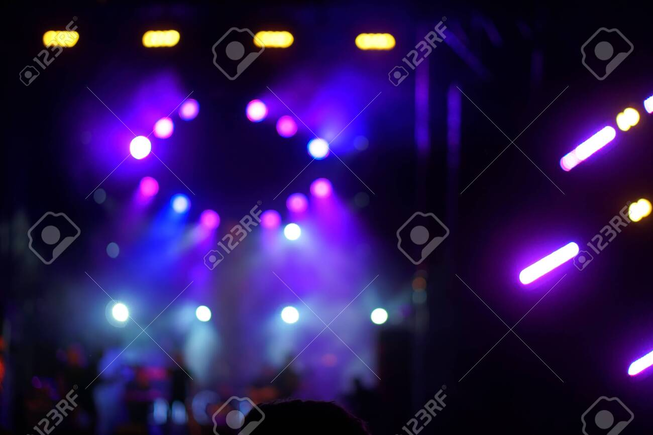 Defocused entertainment concert lighting on stage, blurred disco party. - 131631462