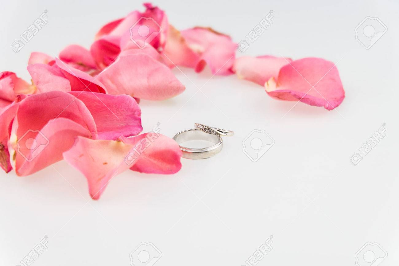 Wedding Ring With Pink Rose Petal On White Background Stock Photo ...