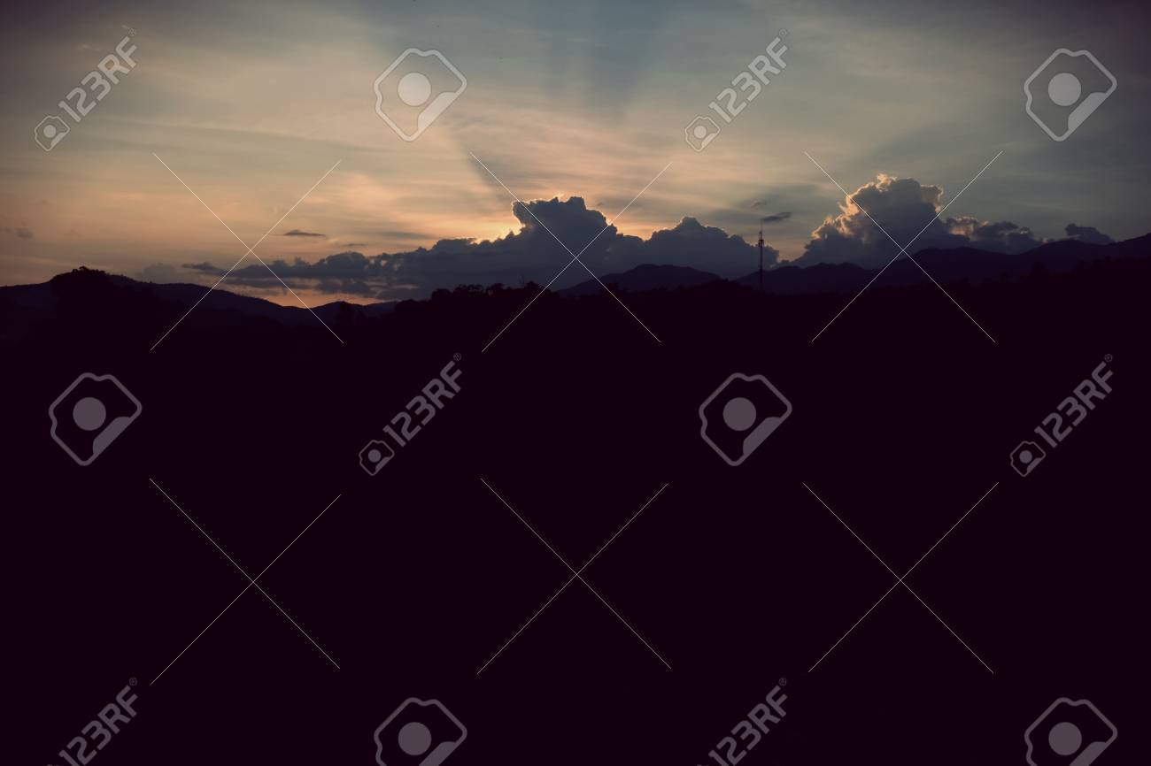 Stock Photo - Sunset sky background with clouds and sun, photo image wallpaper.
