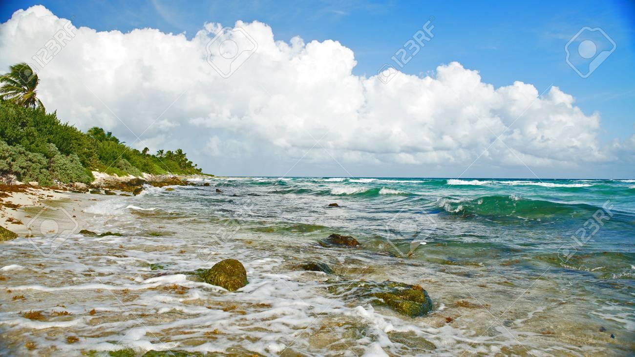 beautiful sun covered beach in cancun mexico blue waves crashing