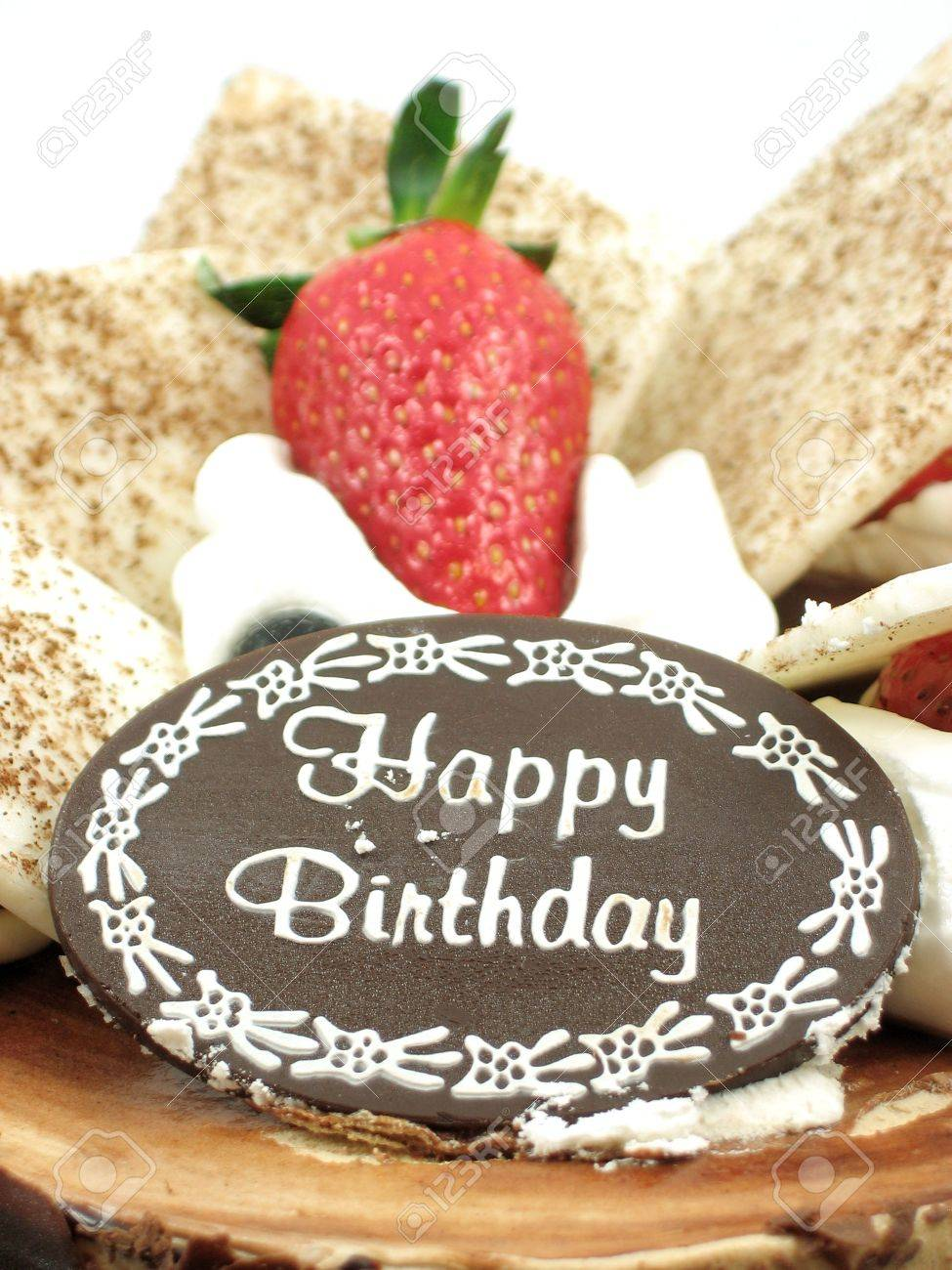 Close Up Of Happy Birthday And A Strawberry Topped On Chocolate Cake Stock Photo