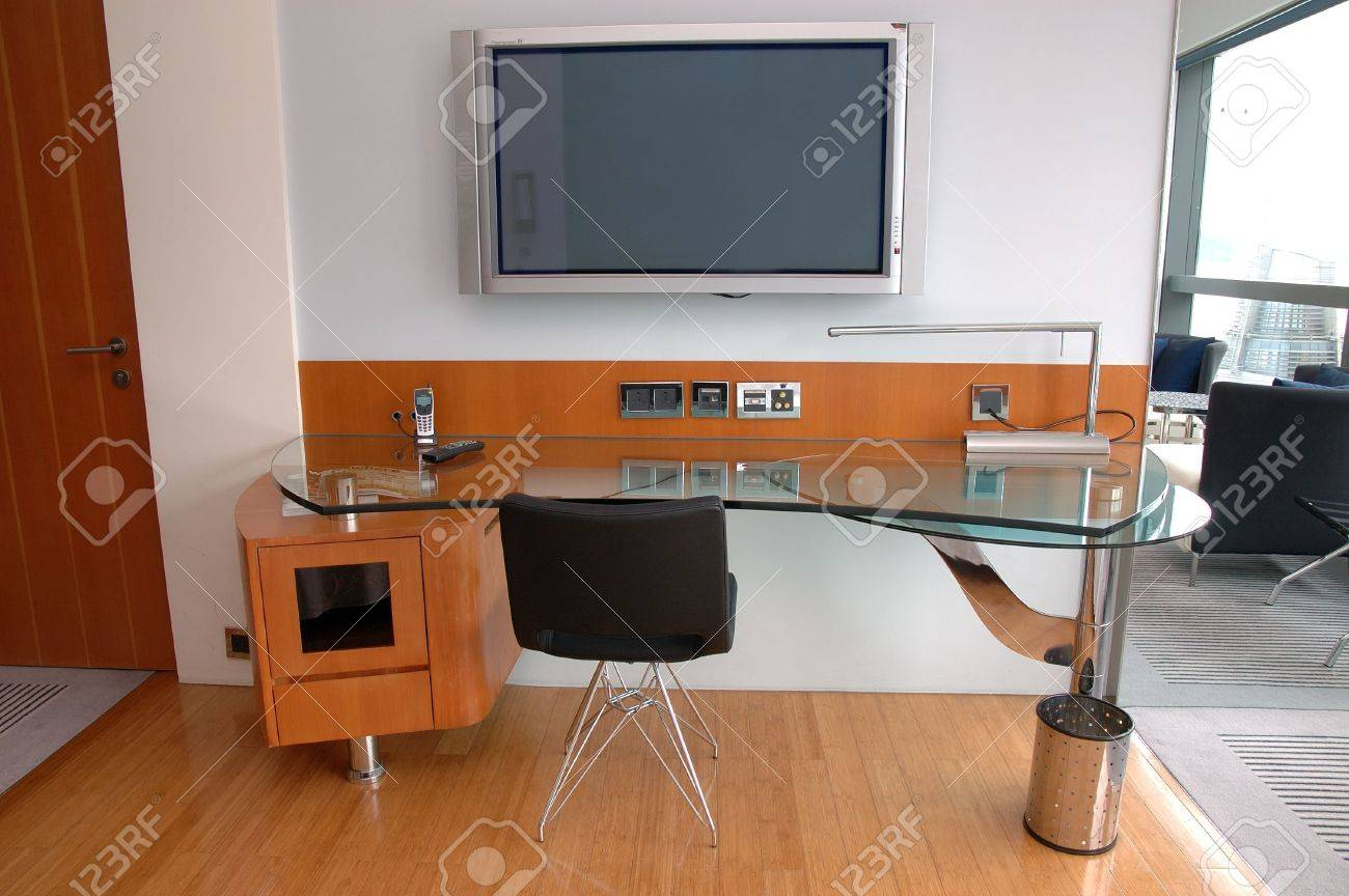work desk with plasma tv in a modern hotel room stock photo