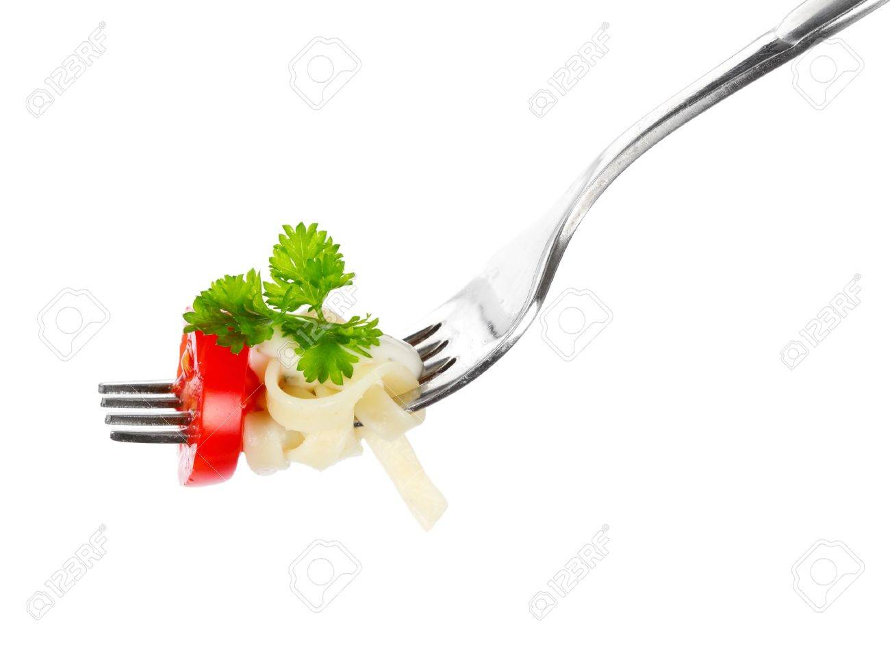Pasta on a fork over white background - 9940037