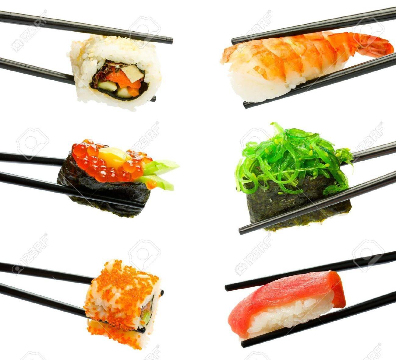 Sushi with chopsticks isolated over white background - 9998850