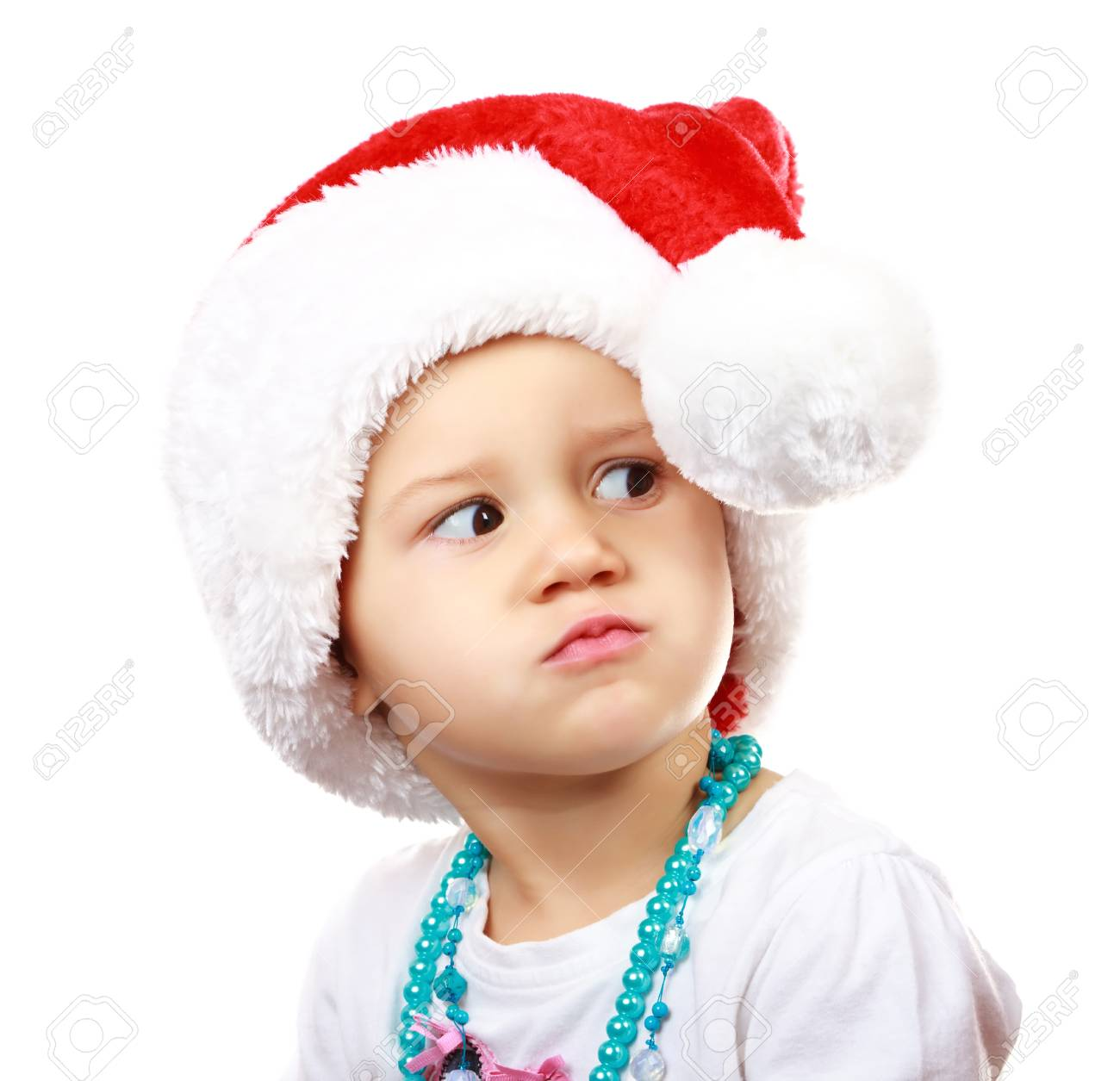 Baby in Santa Claus hat on white background Stock Photo - 11563137