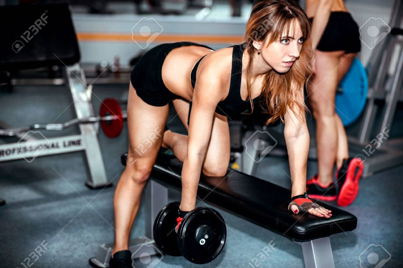 Two Pretty Girls Workout In The Gym Stock Photo, Picture And Royalty Free  Image. Image 49573032.