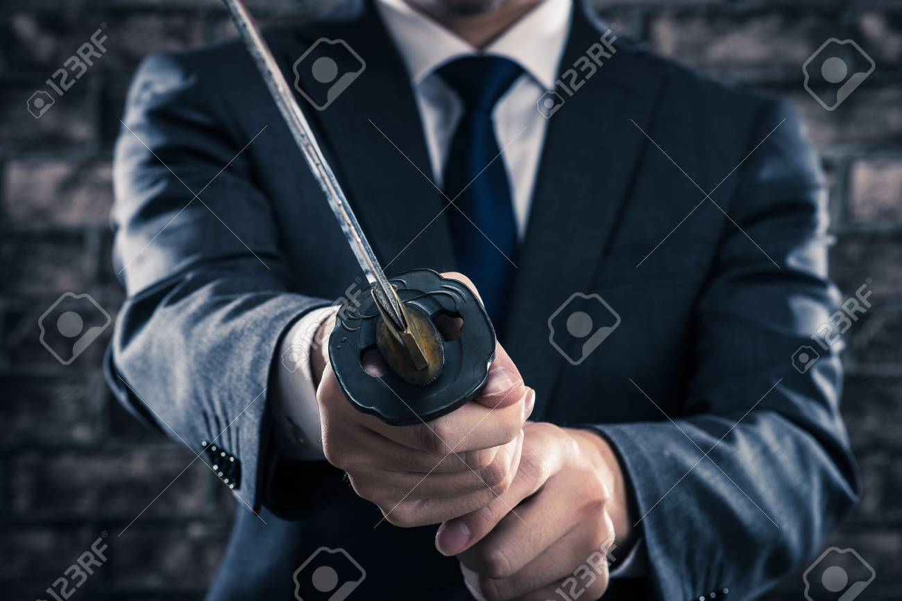 Businessman and japanese sword - 57942892