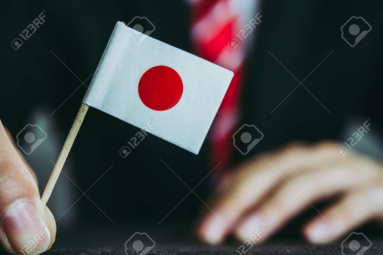 Businessman and national flag - 89913232