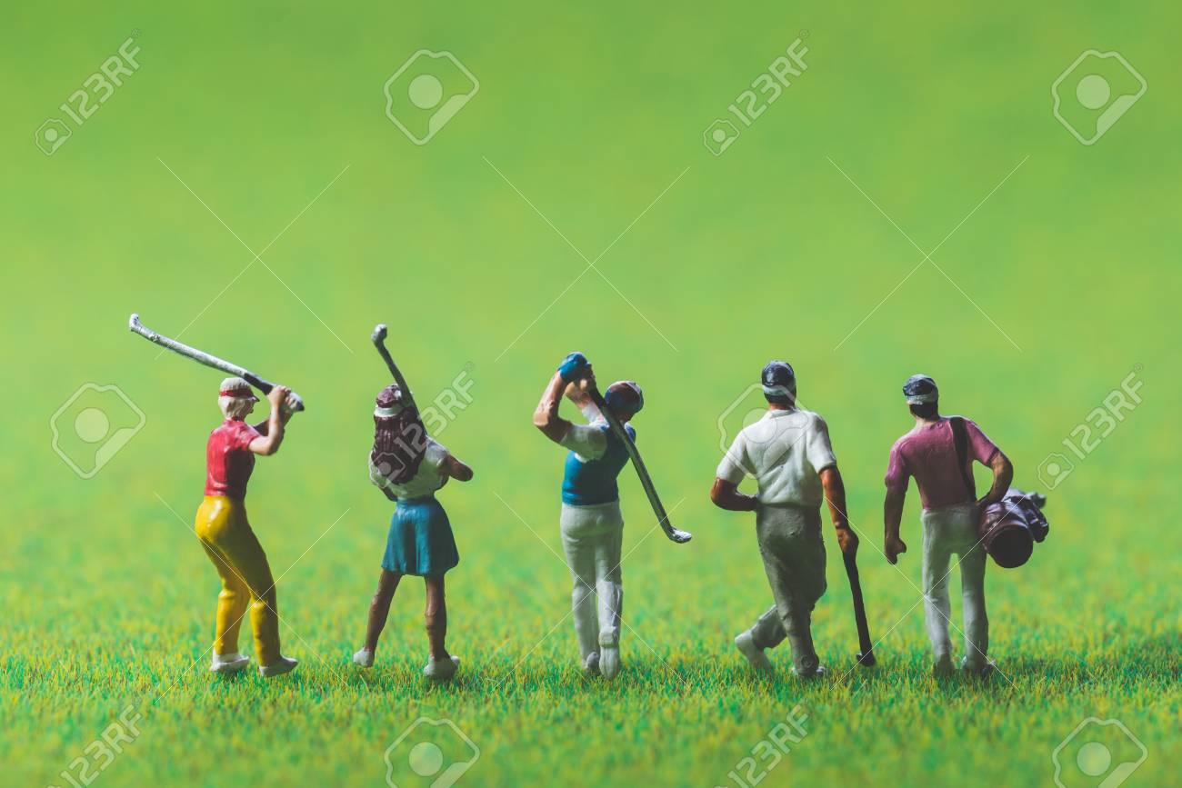 Golfer of miniature people - 96934931