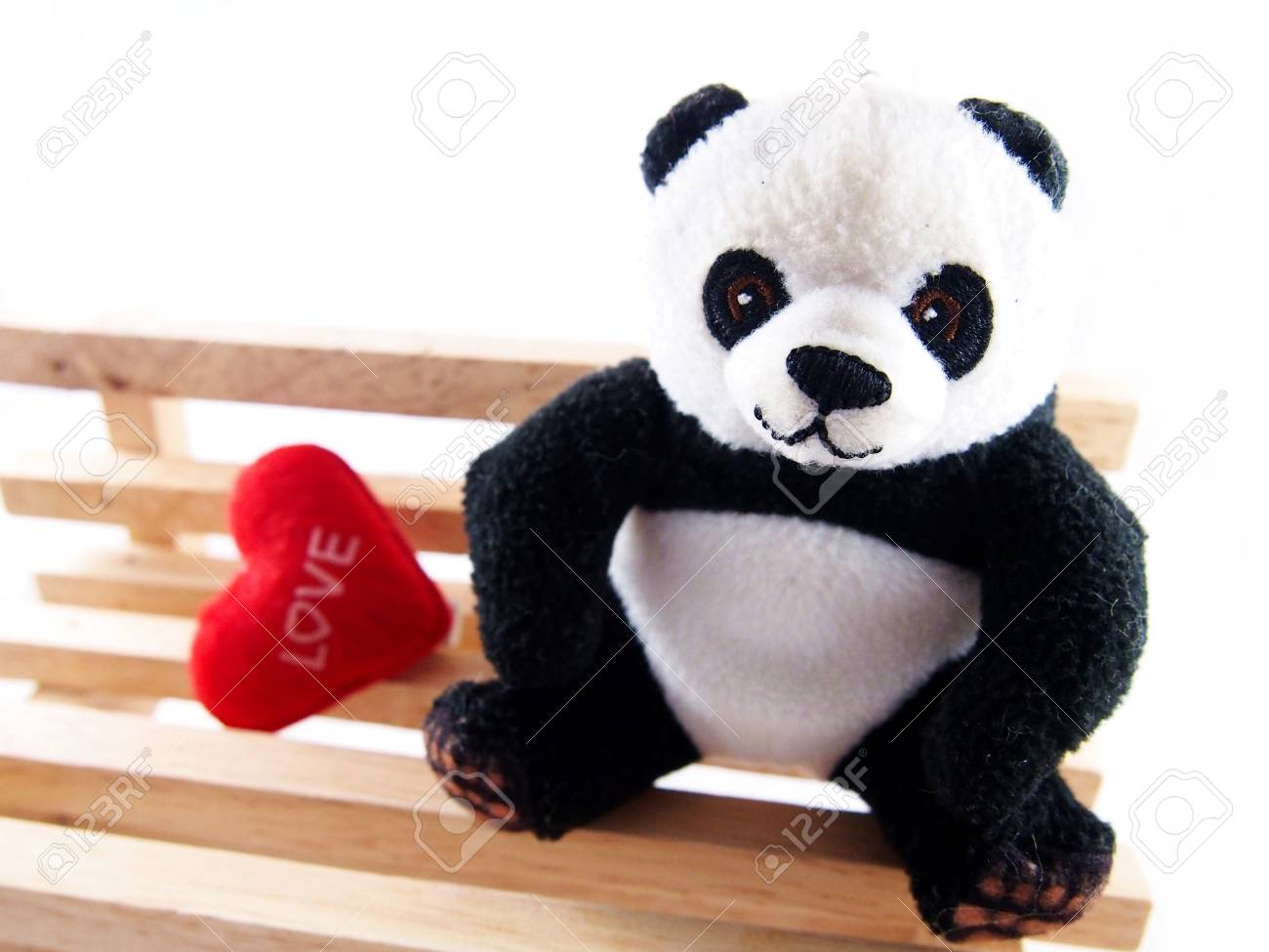 Panda Doll On The Handmade Wooden Chair, Feeling Fall In Love Concept Stock  Photo