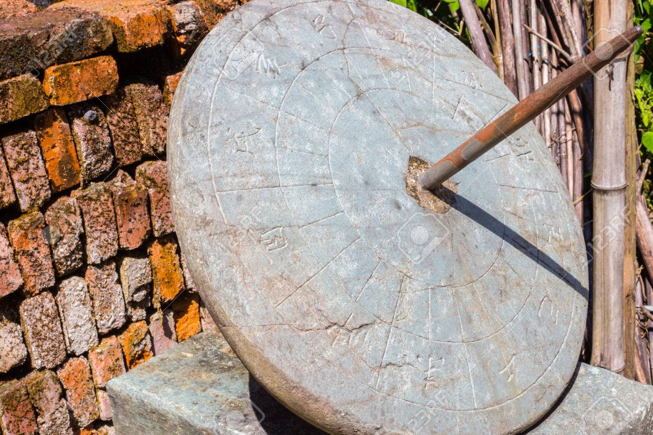 Ancient chinese sundial outside an old town with the old chinese ancient chinese sundial outside an old town with the old chinese characters for the twelve times buycottarizona Choice Image