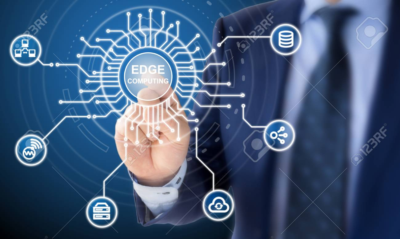 It Expert In A Blue Suit Clicks On A Circuit Diagram With The Words Edge Computing Surrounded By Specific Icons Stock Photo Picture And Royalty Free Image Image 91000295