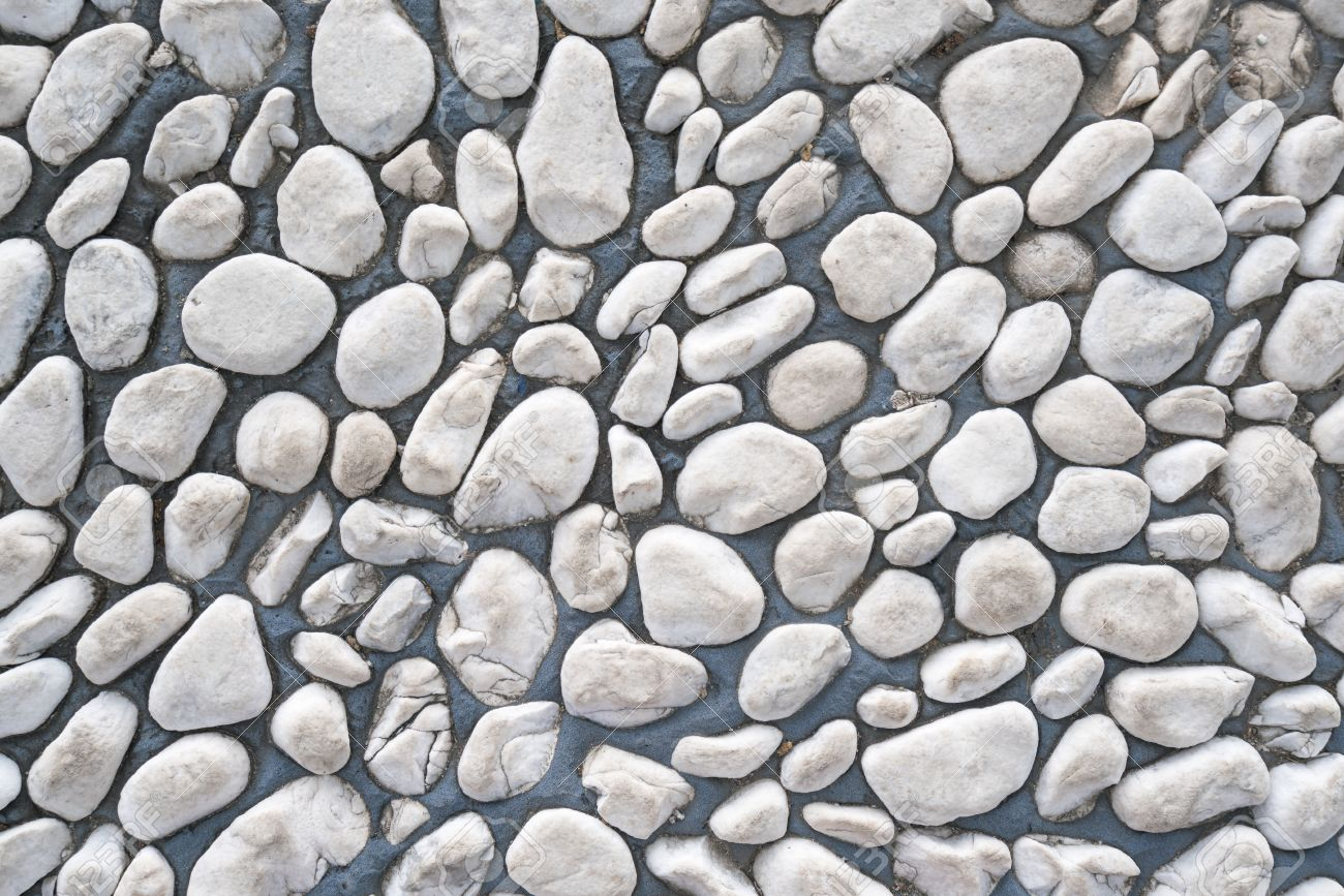 Smooth shaped white stones surface texture background stock photo - White Pebble Stone Cemented Floor Texture Background Stock Photo 59002152