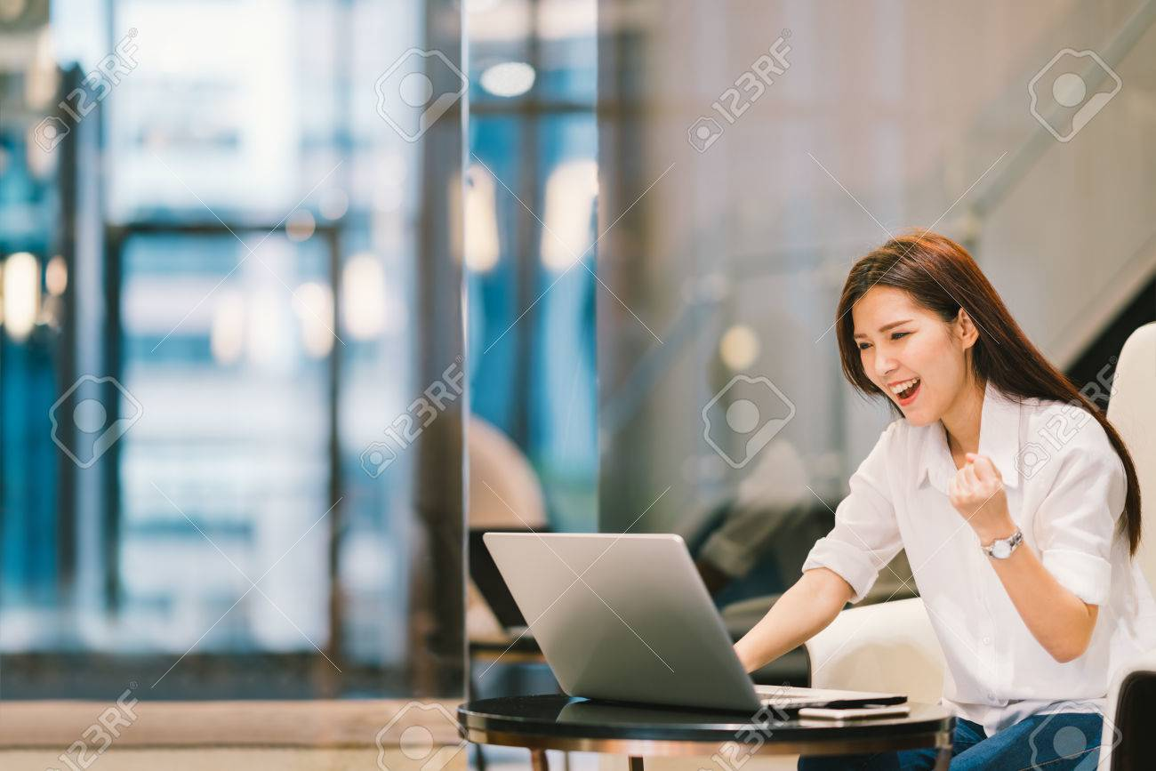 Beautiful Asian girl celebrate with laptop, success pose, education or technology or startup business concept, with copy space - 70820833
