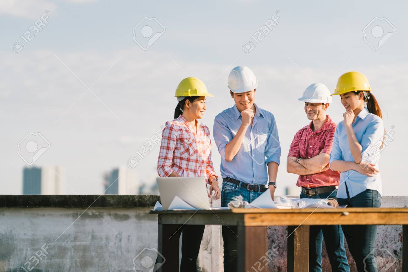 Multiethnic diverse group of engineers or business partners at multiethnic diverse group of engineers or business partners at construction site working together on buildings malvernweather Images