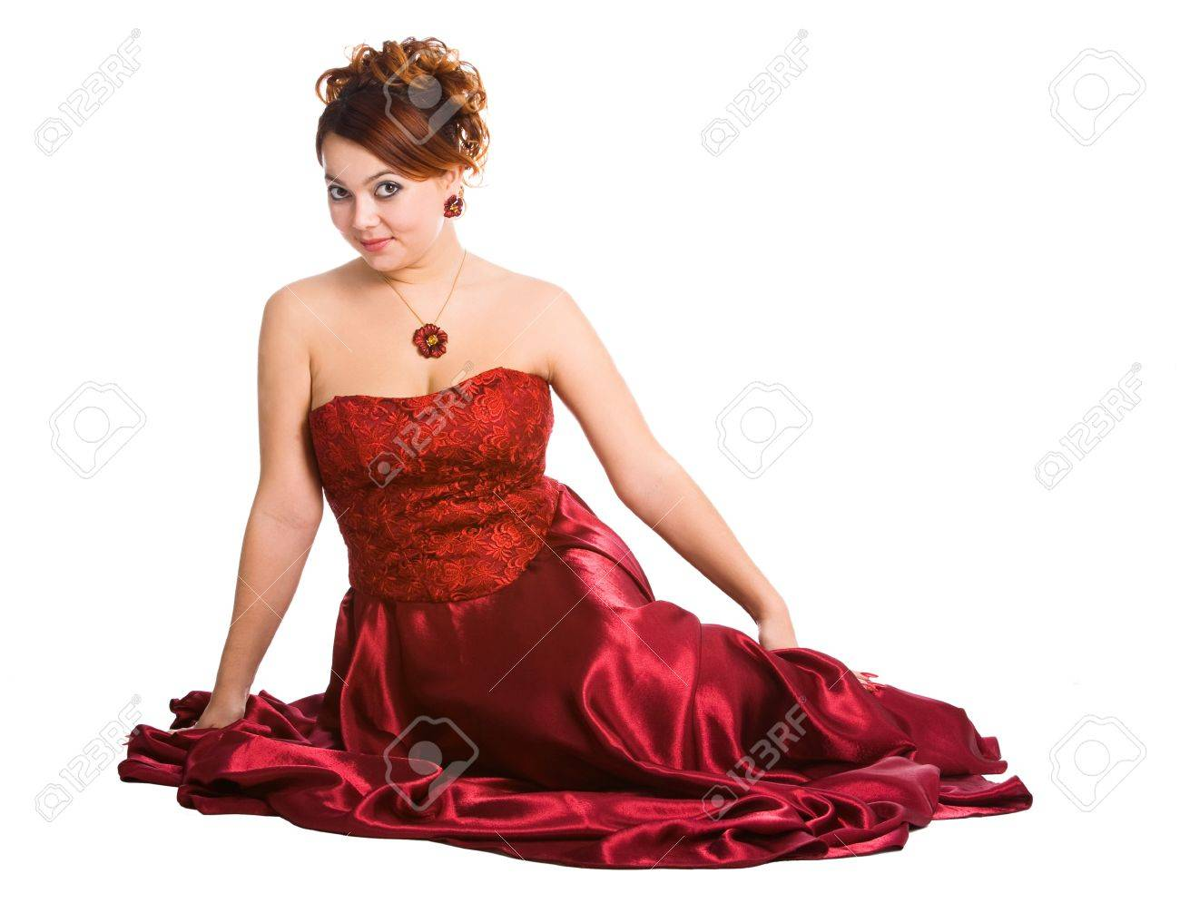 young attractive woman sitting in long red dress. Stock Photo - 9357972