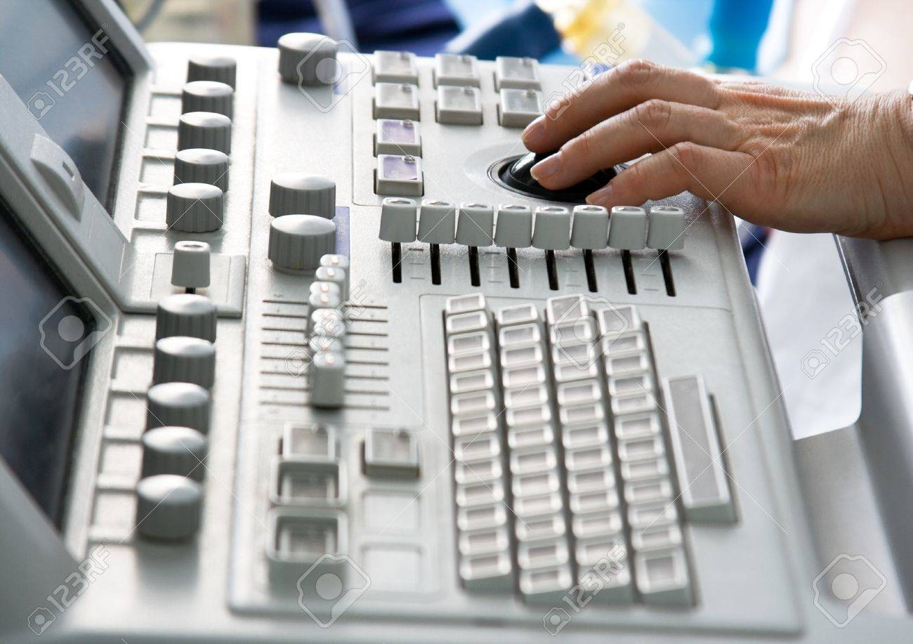 Ultrasound medical device keyboard with doctor's hand. Image with shallow DOF. - 9637268