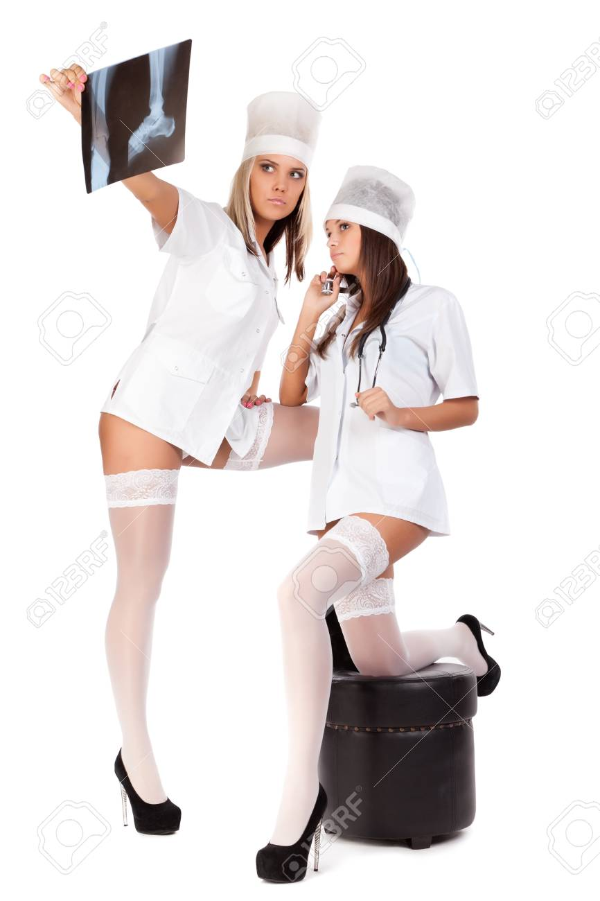 Two young sexual female doctors on white background Stock Photo - 9922153