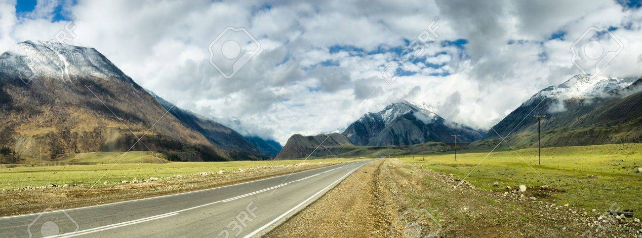 long road in mountains. Altai. panoramic image from several pictures - 10622300