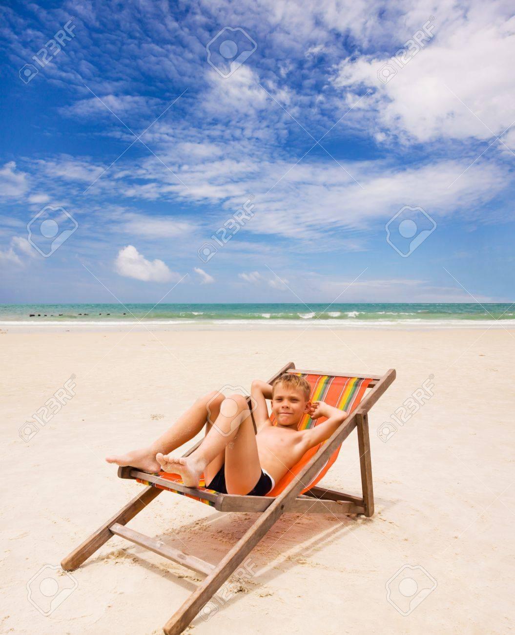 boy in beach chair on the beach - 15072143