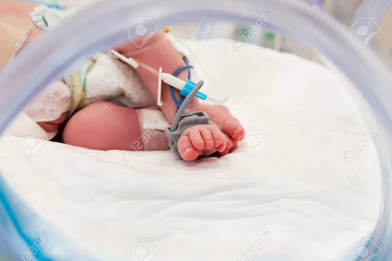 Pulse Oximeter Sensor and Drip Line on the Foot of Newborn Baby at Children's Hospital - 92174291