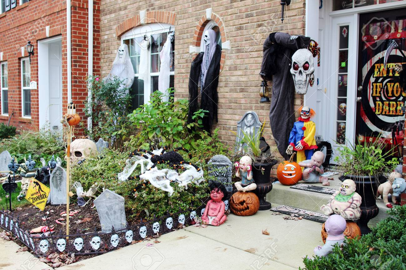Spooky Scene On The Front Porch. Halloween Front Door Decorations Stock  Photo   64434833