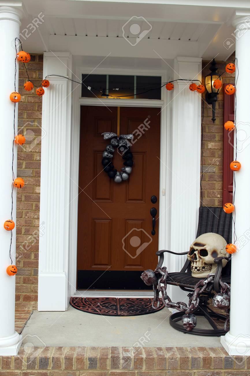 Halloween Front Door Decorations With Skull And Pumpkins Stock Photo    64434835