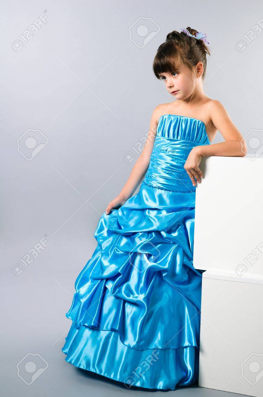 A Cute Girl Posing In A Prom Dress In Studio Stock Photo, Picture ...