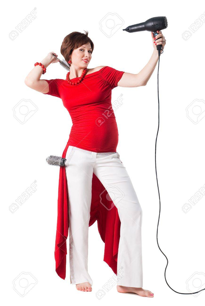 young pregnant woman styling your hair with hairdryer isolated on white background Stock Photo - 12130031