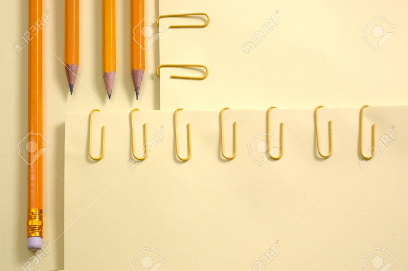 Colorful Papers Yellow page and pencil on yellow background with soft shadow Stock Photo - 4253166