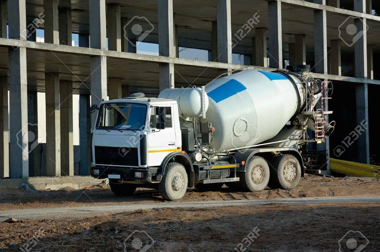 car mixer against a building under construction stock photo